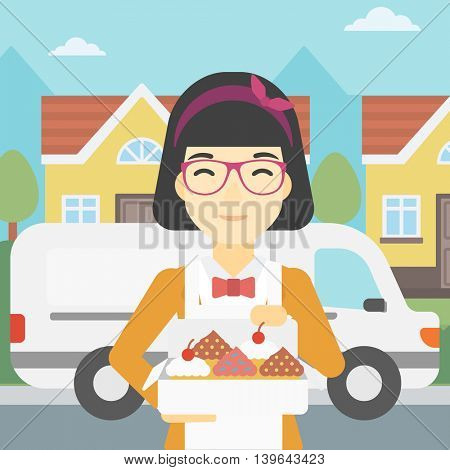 An asian  female baker holding a box of cakes. A baker delivering cakes. Baker with cupcakes standing on the background of delivery truck. Vector flat design illustration. Square layout.