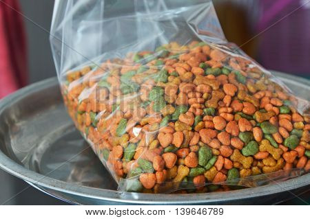 dog food in plastic bag for packing on weighing scale