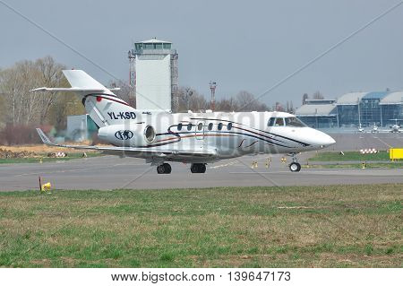 Kiev Ukraine - April 14 2012: Hawker 850XP business jet is taxiing to the runway in the airport