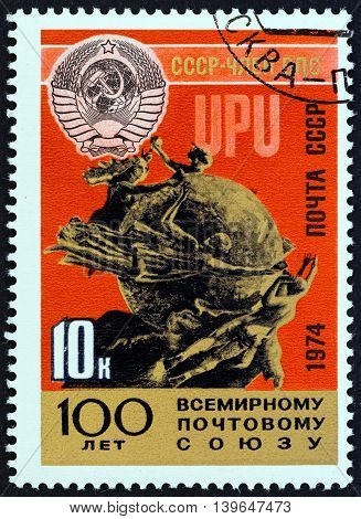 USSR - CIRCA 1974: A stamp printed in USSR issued for the Centenary of U.P.U. shows Soviet Crest and U.P.U. Monument, Berne, circa 1974.
