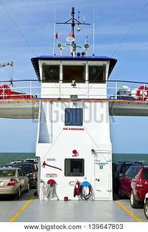 OUTER BANKS, USA - JUNE 3, 2012: cars on the ferry on the way to the outer banks islands.