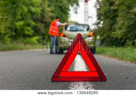 Broken Car On The Road And Warning Triangle