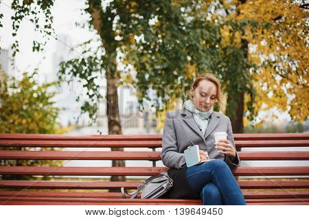 Trendy Woman In Stylish Coat Sitting