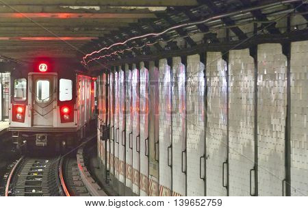 train arrives in the underground station in New York