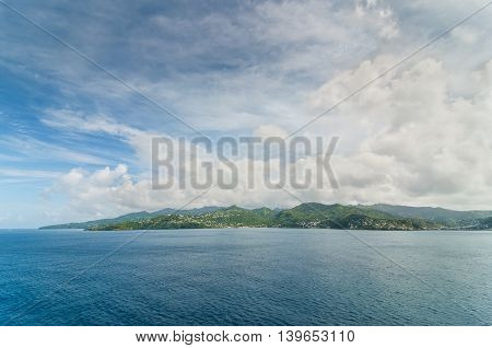 Grenada W.I. coastline. Grenada is an island country consisting of Grenada itself and six smaller islands at the southern end of the Grenadines in the southeastern Caribbean Sea.