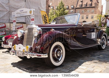 Nurnberg Bavaria / Germany - July 19th 2014: burgundy Mercedes-Benz 170S cabriolet A vintage car at Sud - Rallye- Historic event in Nurnberg