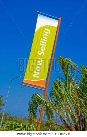 Now Selling Banner On Street Pole