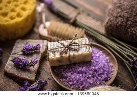 Spa lavender concept: lavender flowers handmade soap and sea salt
