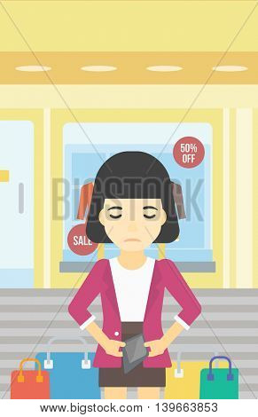 An asian young woman showing her epmty wallet on the background of showcase of a store. Bankruptcy concept. Vector flat design illustration. Vertical layout.