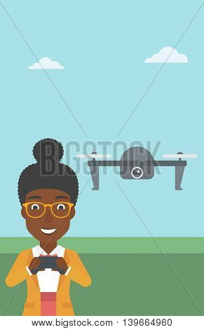 An african-american woman flying drone with remote control. Happy woman operating a drone with remote control. Woman controling a drone. Vector flat design illustration. Vertical layout.