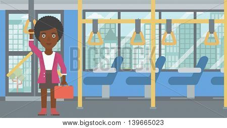 An african-american woman traveling by public transport. Young woman standing inside public transport. Woman traveling by passenger bus or subway. Vector flat design illustration. Horizontal layout.