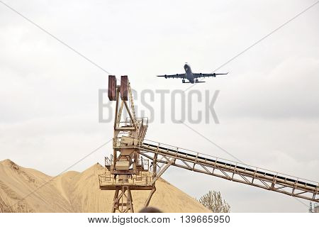 Aircraft In Landing Approach Over Gravel Pit
