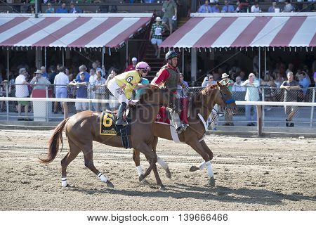 SARATOGA SPRINGS, NY - July 22: Summer Sally in the Post Parade for the 98th runniing of the Schulerville Stakes for 2 year old Fillys on July 22 in Saratoga Springs, NY.