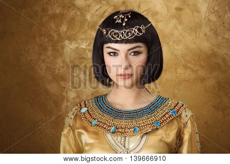 Fashion Stylish Beauty Portrait with Black Short Haircut and Professional Make-Up of Cleopatra. Beautiful Girl's Face Close-up.