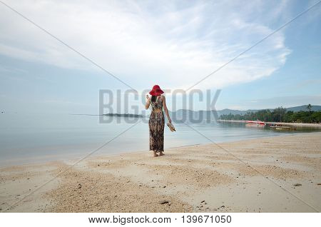 Beautiful woman walk on the beach in Koh Samui, Surat Thani Province, Thailand