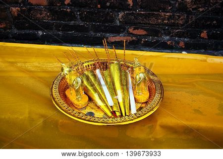 oblations sacrificial offerings for Lord Buddha at the temple of Wat Yai Chai Mongkol in Ayutthaya