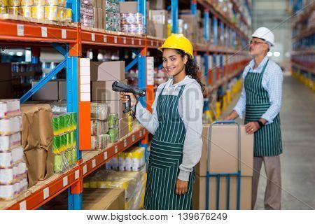 Colleague using digital equipment in warehouse