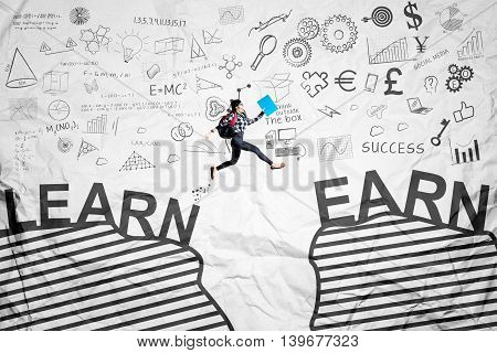 Image of female student jumping through a gap with learn and earn words shot with crumpled paper background