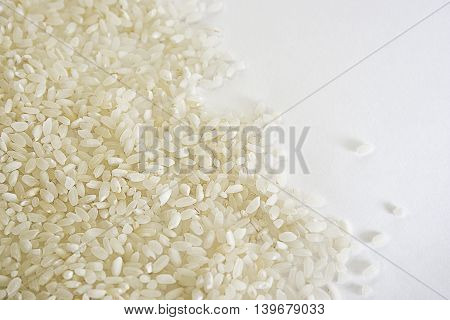 texture from grains of rice spillage on white background
