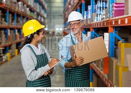 Coworkers looking at each other in warehouse