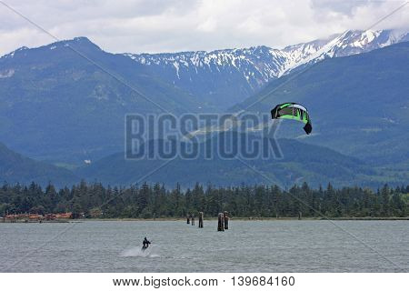 Kitesurfers riding in the Howe Sound in Squamish, Canada
