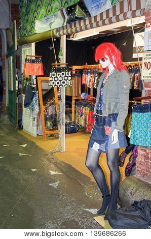 FREMANTLE,WA,AUSTRALIA-JUNE 25,2016: Female mannequin with vivid hair outside a market stall in the Fremantle Markets with skirt shop in Fremantle, Western Australia.
