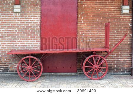 a old railroad luggage cart sits long forgotten.