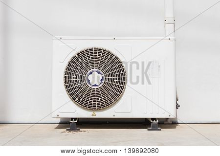 air conditioning fixed to a wall background.