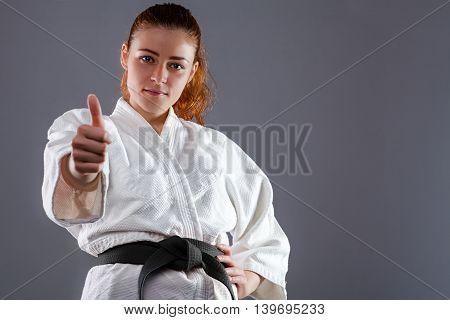 Woman Wearing Karate Kimono with Thumbs Up
