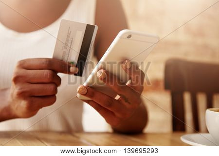 People And Technology Concept. Cropped Portrait Of Young Woman Wearing White Top Holding Credit Card