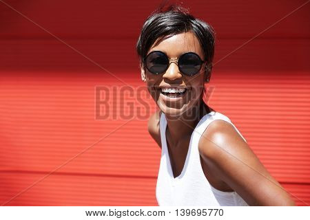 People And Lifestyle Concept. Portrait Of Fashionable African Woman Wearing Round Hipster Sunglasses