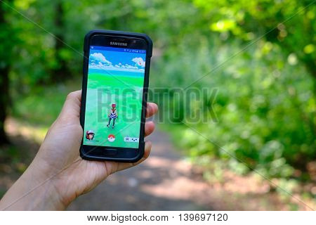 Moscow, Russia - July 24: Female hand holding a Samsung Galaxy S7 smartphone with a running Pokemon Go application.
