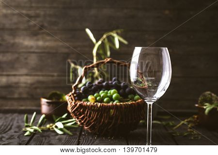 Wine glass with grapes. Fresh grapes on wood. Autumn fruit