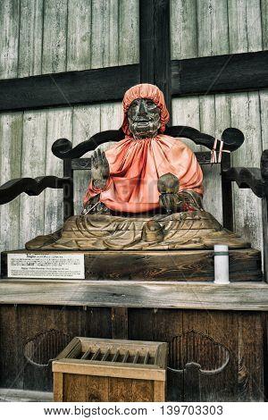 Nara - July 2016: Binzuru, healing Buddha in front of Daibutsuden Great Buddha Hall. Todai-ji Temple.
