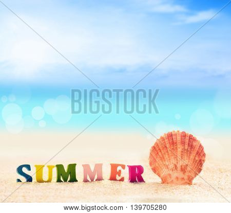 Summer beach. Word summer of color letters on summer beach and seashell on a background of ocean.