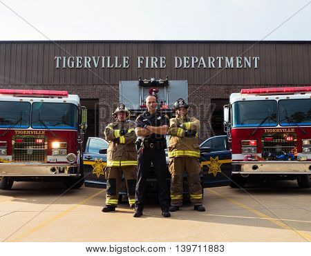 Firefighters standing behind police officer to show support