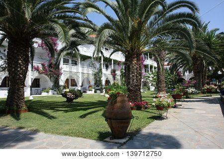 NIKITI,GREECE-JUl 07 2016: View at inboard garden in Porfi Beach hotel, Greeece