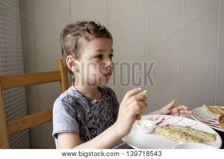 Child Eating Pancake