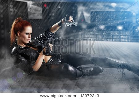 beautiful sexy girl holding gun . smoke background poster