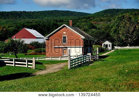 Hancock Massachusetts - September 17 2014: View to the Poultry House (center) Garden Tool Shed (right) and the Berkshire Hills at the Hancock Shaker Village