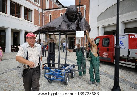 CRACOW; POLAND - JULY 22; 2016: The installation of the bust - In homage to John Paul II by Anna Gulak in the Centre of Pope John Paul II in Lagiewniki before WYD 2016.Cracow Poland
