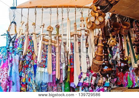 VELIKY NOVGOROD RUSSIA-JULY 22 2016. Souvenir trade - various wooden souvenir objects made of wood in traditional Russian style at the street souvenir trade