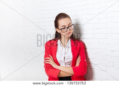 Businesswoman serious upset look down ponder wear red jacket glasses thinking business woman over office wall