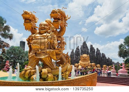 Ho Chi Minh city ( Saigon ) Vietnam - September 02 2015: Fountain with gold dragon and buddha statues in water park and historical theme amusement park Suoi Tien - best south Vietnam cultural park.