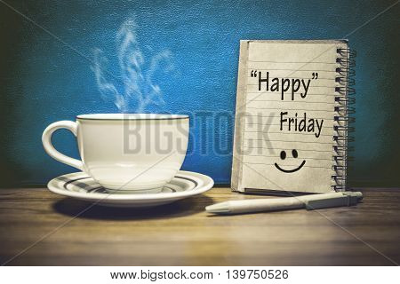 Inspirational quote - Happy Friday on notepad retro style background. Focus Text message on notepad area .