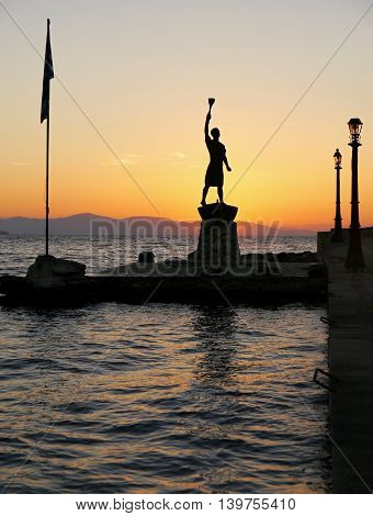 Statue near the sea and sky color before sunrise