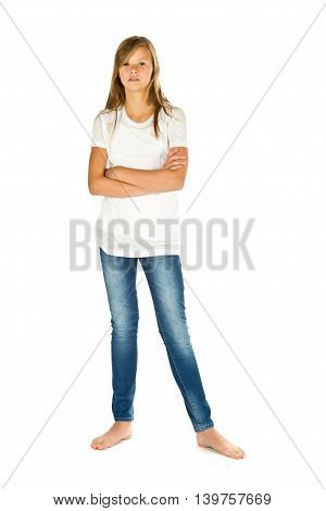 Young girl standing barefoot with white t-shirt and blue jeans over white background