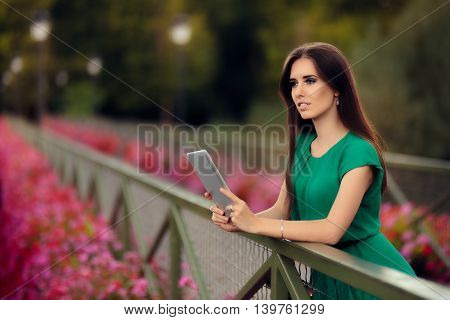 Woman with Digital Tablet on a Bridge with Flowers