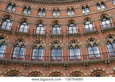 ST PANCRAS RENNAISANCE HOTEL, KING'S CROSS, LONDON, UK - JULY 21, 2016. The curved facade and exterior of the five star, luxury St Pancras Rennaisance Hotel in London which is a popular tourist destination and an excellent example of London architecture.