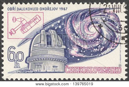 MOSCOW RUSSIA - JANUARY 2016: a post stamp printed in CZECHOSLOVAKIA shows Ondrejov Observatory and Universe devoted to the 13th International Astronomic Union Congress Prague circa 1967